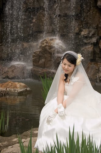 Jiajia in a wedding dress in the park